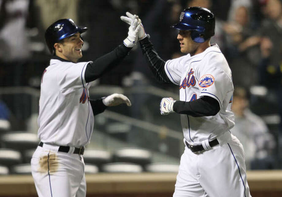 Mets' Jason Bay, right, celebrates hitting an inside-the-park home run in the eighth inning. Photo: Nick Laham, Getty Images