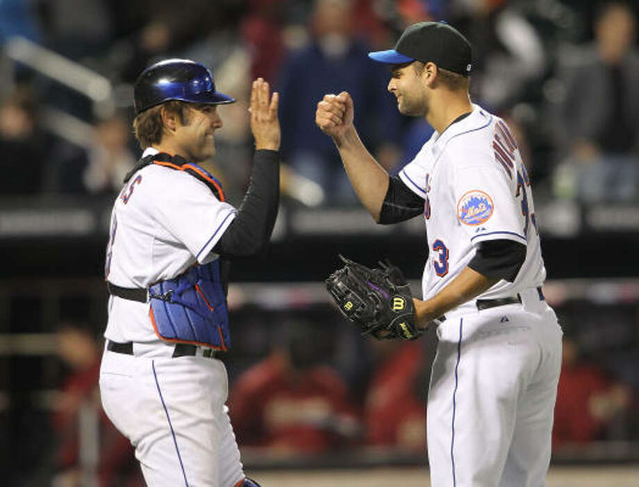 Mets catcher Mike Nickeas Mets celebrates the win with teammate Taylor Buchholz. Photo: Nick Laham, Getty Images