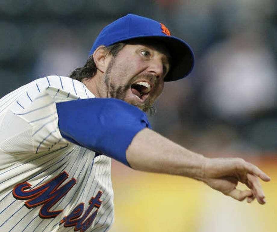 Mets pitcher R.A. Dickey follows through on a delivery. Photo: Paul J. Bereswill, AP