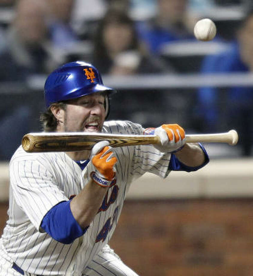 Mets pitcher R.A. Dickey attempts to lay down a sacrifice bunt, but he pops out. Photo: Paul J. Bereswill, AP