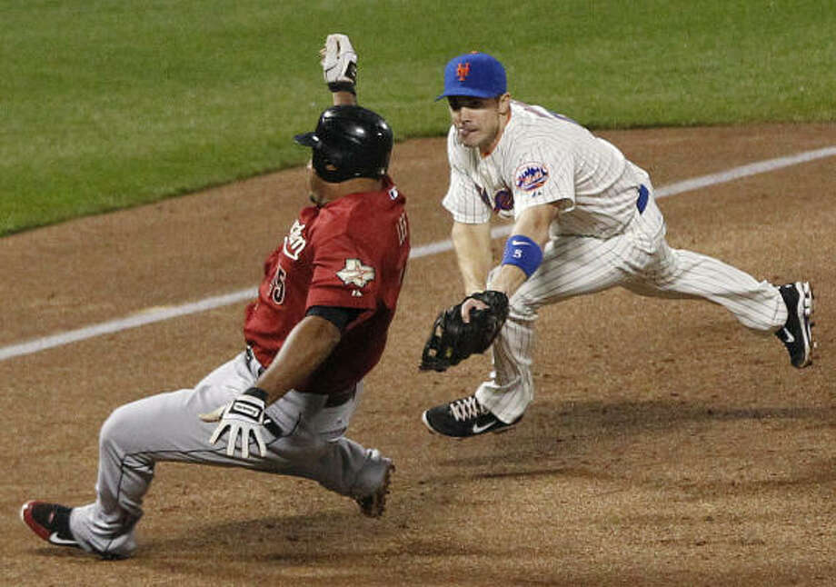 April 19: Astros 6, Mets 1Mets third baseman David Wright, right, tags out Carlos Lee during the third inning of Tuesday's game. Photo: Frank Franklin II, AP
