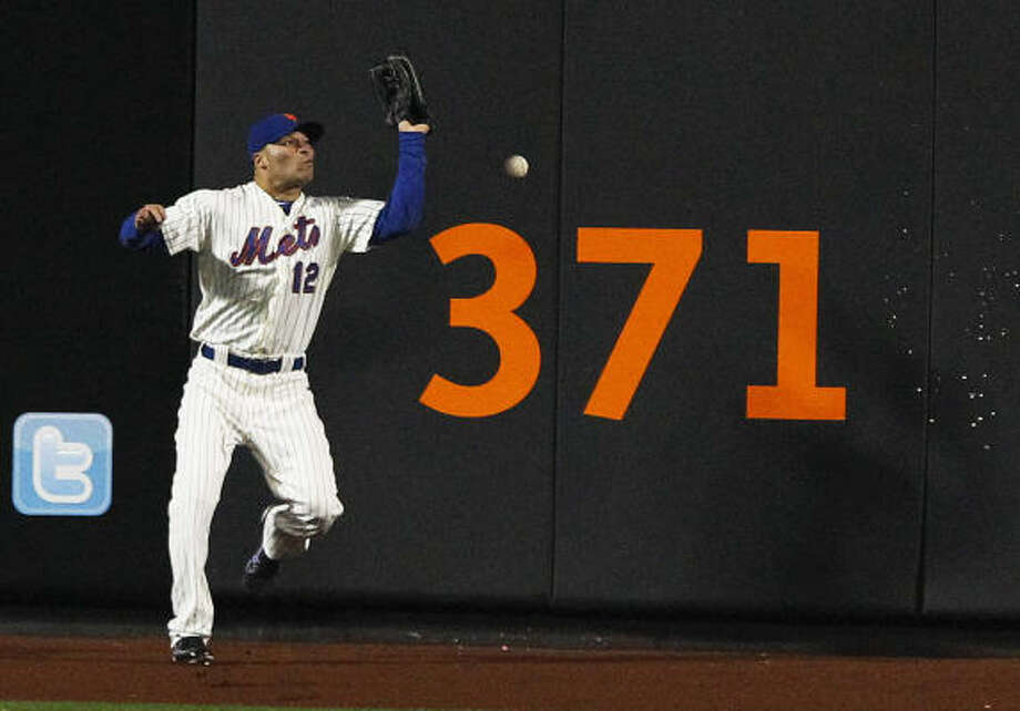 New York's Scott Hairston drops a fly ball hit by Carlos Lee, allowing a run during the seventh inning. Photo: Frank Franklin II, AP
