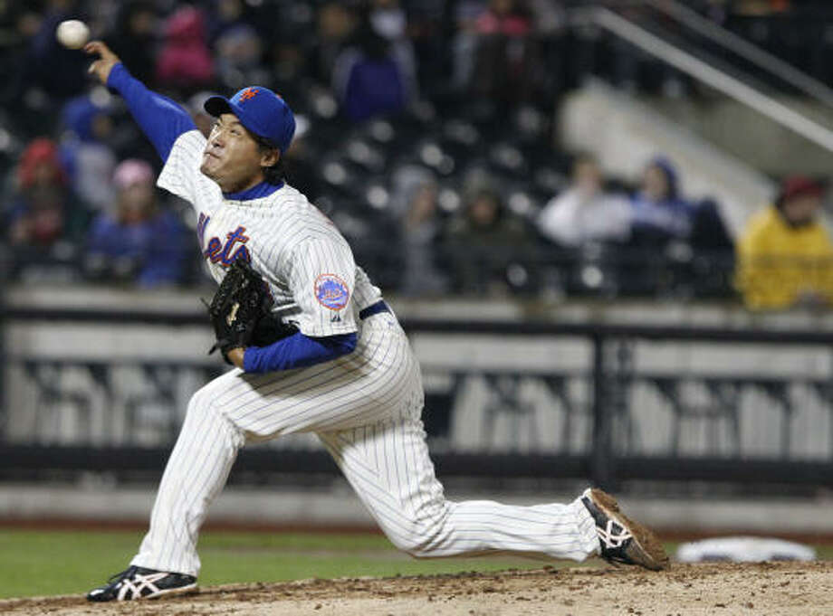 New York's Ryota Igarashi delivers a pitch during the eighth inning. Photo: Frank Franklin II, AP