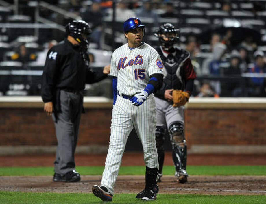 New York's Carlos Beltran walks back to the dugout after striking out looking in the bottom of the fourth inning. Photo: Christopher Pasatieri, MCT