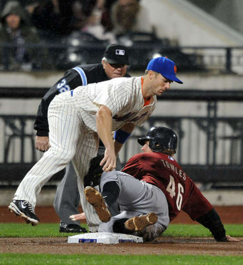 Mets third baseman David Wright, top, tags out J.R. Towles in the fourth inning. Photo: Christopher Pasatieri, MCT