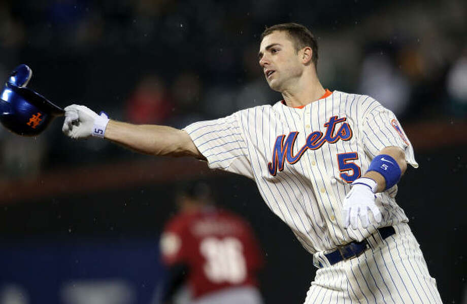 New York's David Wright throws his helmet after flying out in the first inning. Photo: Nick Laham, Getty Images
