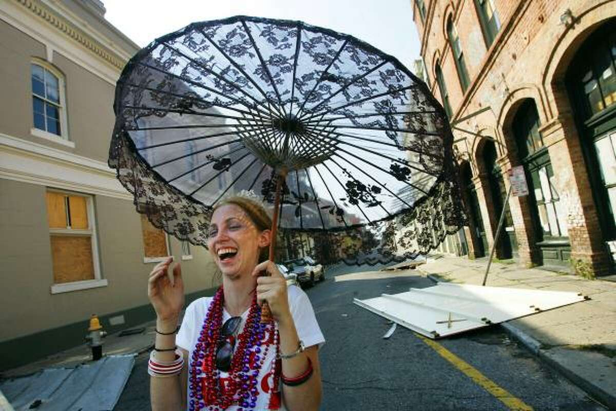 NEW ORLEANS - SEPTEMBER 04: Candice Jameson, 21, laughs with friends while parading around in costume in the French Quarter September 4, 2005 in New Orleans, Louisiana. Jameson and some friends decided to try and bring some cheer to the deserted area, once one of the more vibrant party neighborhoods in the United States.