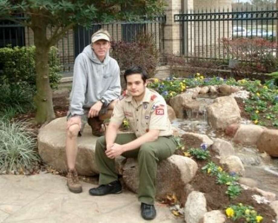 Morton Ranch High School senior Daniel Fahey, right, received help on his Eagle Scout project at Kingsland Baptist Church from Steve Parker, owner of Alpine Aquascapes. Photo: Handout, COURTESY ALPINE AQUASCAPES