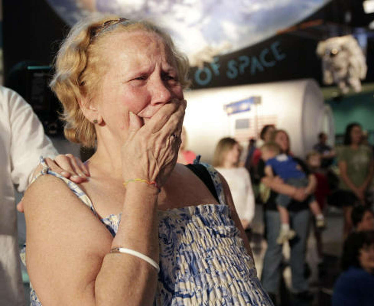 Diane Breener of Houston reacts as NASA administrator Charles Bolden announces from the Kennedy Space Center which museums will receive Space Shuttles once the fleet is retired on Tuesday April 12, 2011. Shuttles will be going to the Smithsonian Institution, the Intrepid Sea, Air and Space Museum in New York, the Kennedy Space Center in Florida and the California Science Center in Los Angeles.