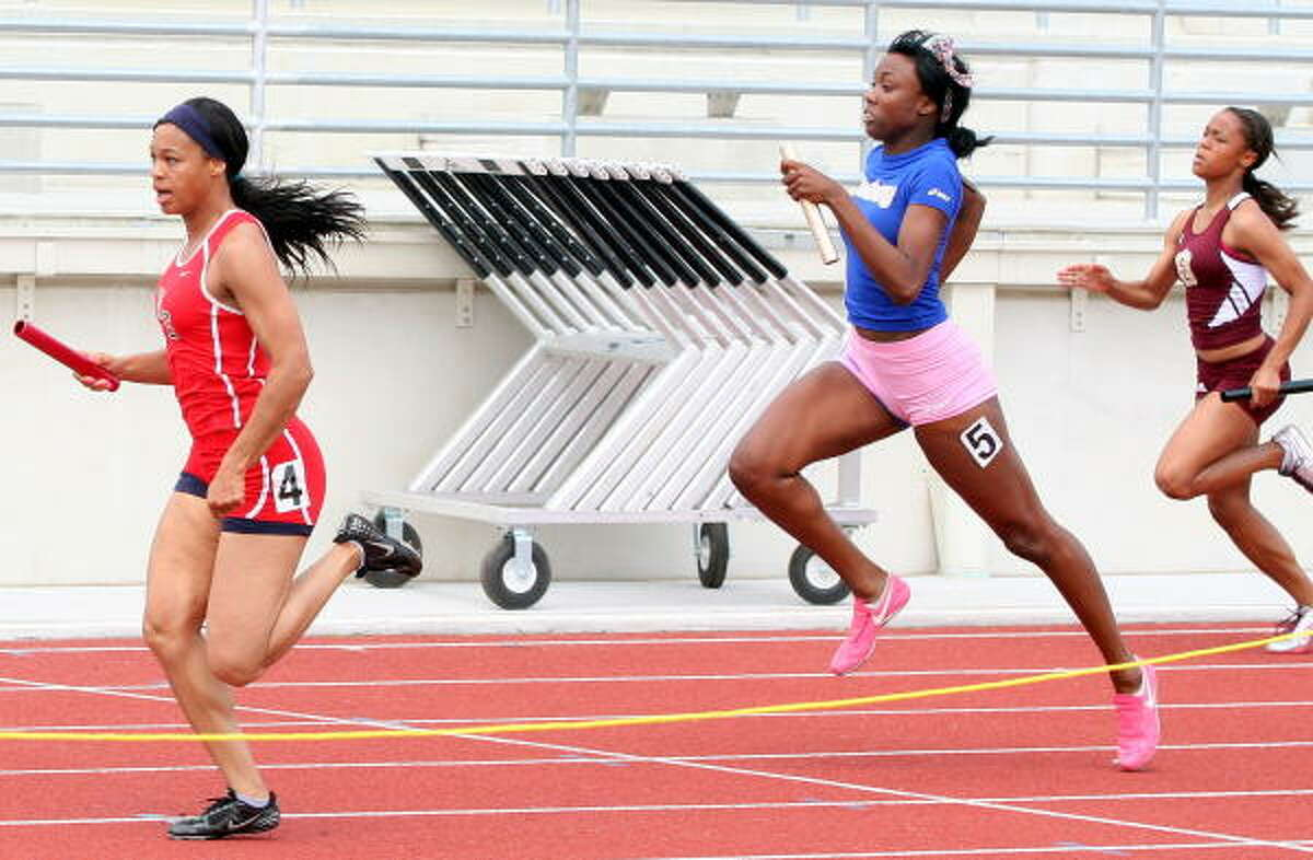 North Shore's Raquel Sims, left, helped bring home the gold for her team in the 400-meter relay.
