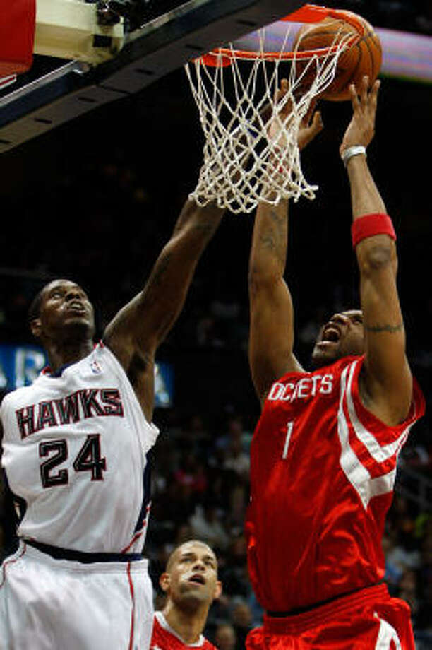 The Rockets' Tracy McGrady, right, fights for a rebound with Marvin Williams of the Atlanta Hawks. Photo: Chris Graythen, Getty Images