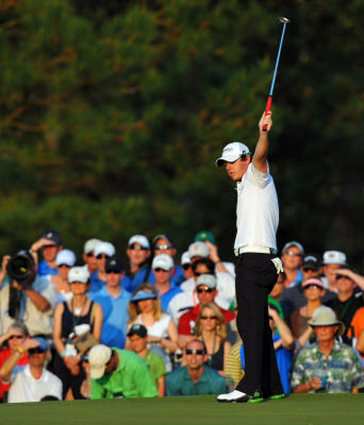 Rory McIlroy reacts after sinking a long birdie putt on the 17th hole during the third round of the 75th Masters at Augusta National Golf Club on Saturday. McIlroy heads into the final round with a four-shot lead.