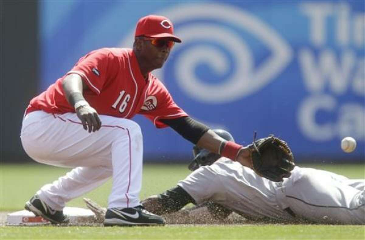 April 7: Astros 3, Reds 2 Edgar Renteria of the Reds can't hold onto the ball as Jason Bourgeois of the Astros slides safely into second with a stolen base