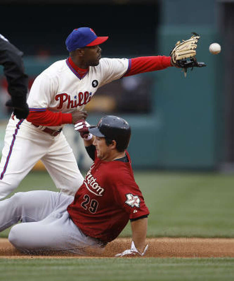 Philadelphia Phillies' Jimmy Rollins, top, catches the throw as Houston Astros' Brett Wallace slides safely into second base during the seventh inning. Wallace scored one of the Astros' four runs. Photo: Matt Rourke, AP