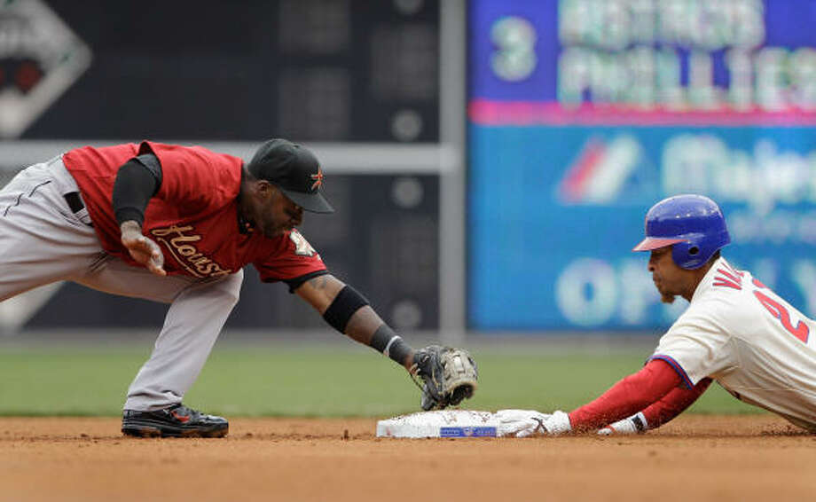 Second baseman Bill Hall of the Houston Astros applies the late tag as Wilson Valdez of the Philadelphia Phillies slides safely into the bag for a double during the third inning. Photo: Rob Carr, Getty Images