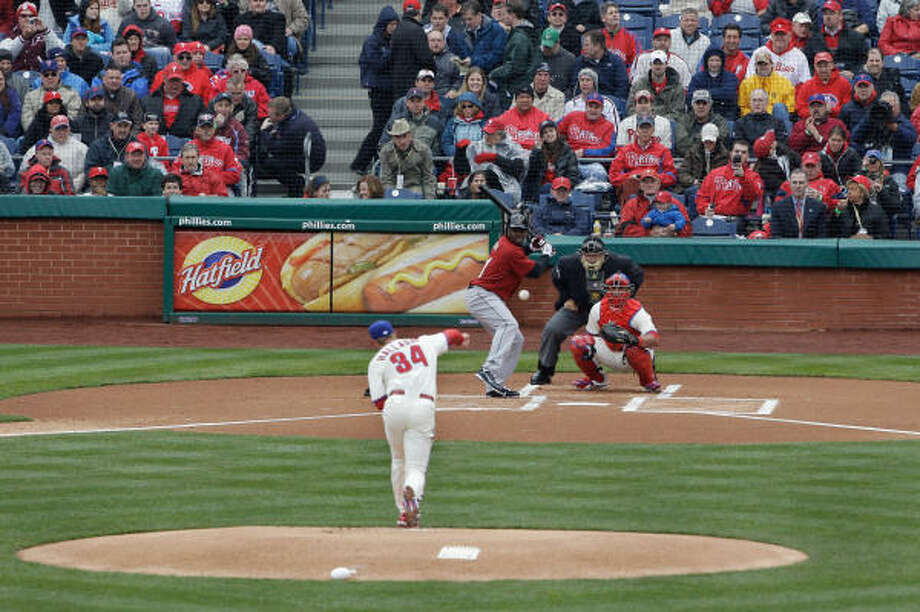 Starting pitcher Roy Halladay of the Philadelphia Phillies delivers the first pitch of opening day to batter Michael Bourn of the Houston Astros. Halladay threw eight straight outs before Brett Myers hit a single and became the Astros first baserunner of the game. Photo: Rob Carr, Getty Images