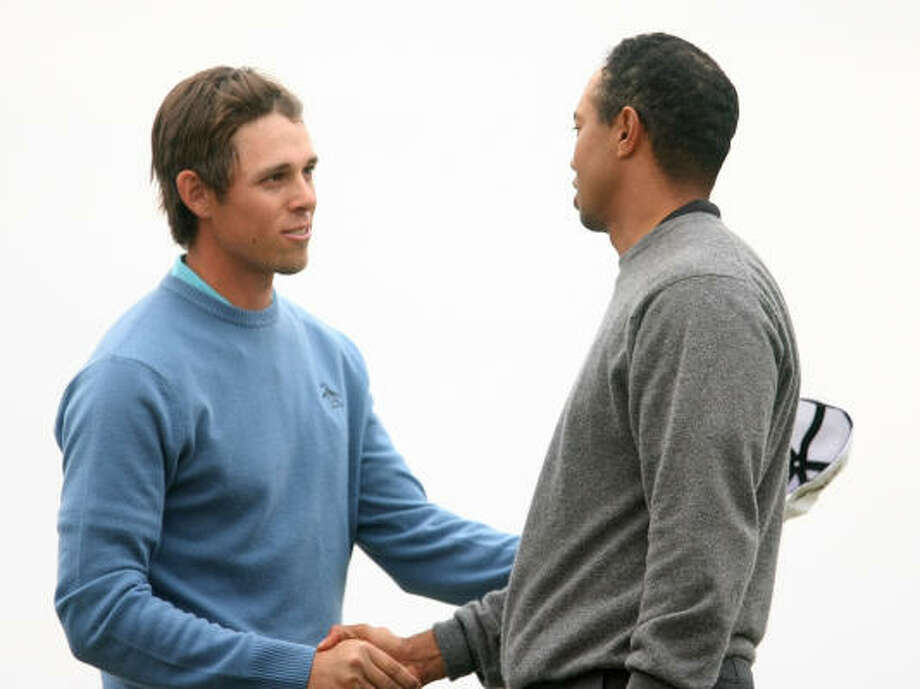 Tiger Woods, right, shakes hands with Aaron Baddeley after winning on the 20th hole during the third round of the WGC-Accenture Match Play Championship on Friday. Photo: Scott Halleran, Getty Images