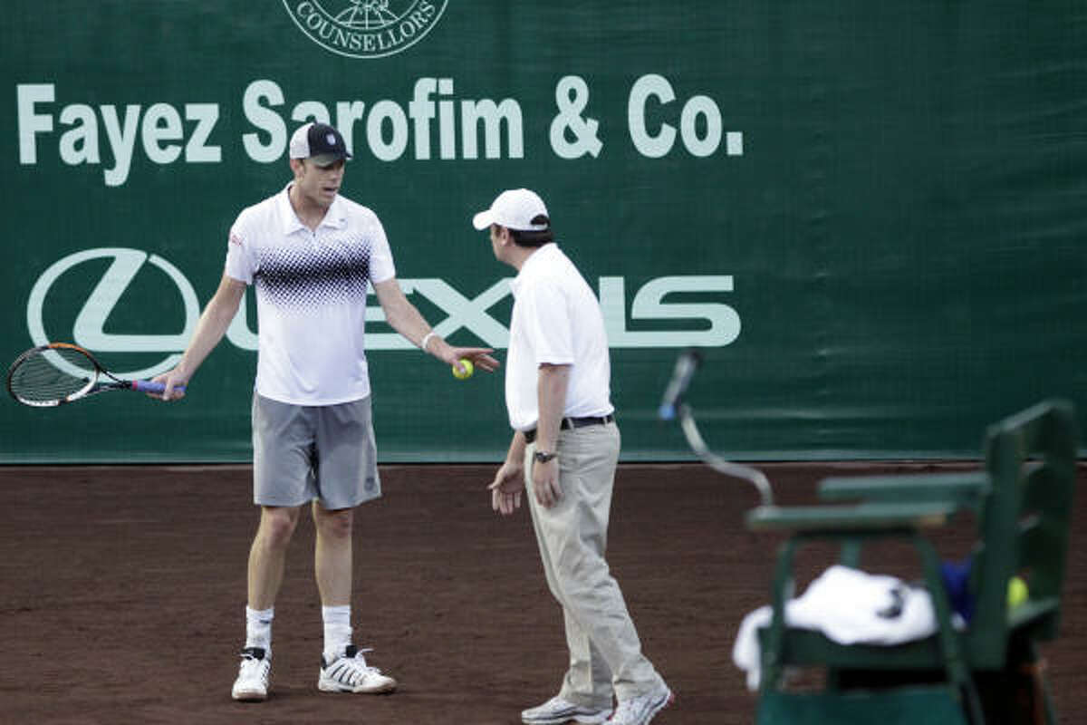 Sam Querrey argues a line call with chair umpire, Jake Garner during a match against Ryan Sweeting.