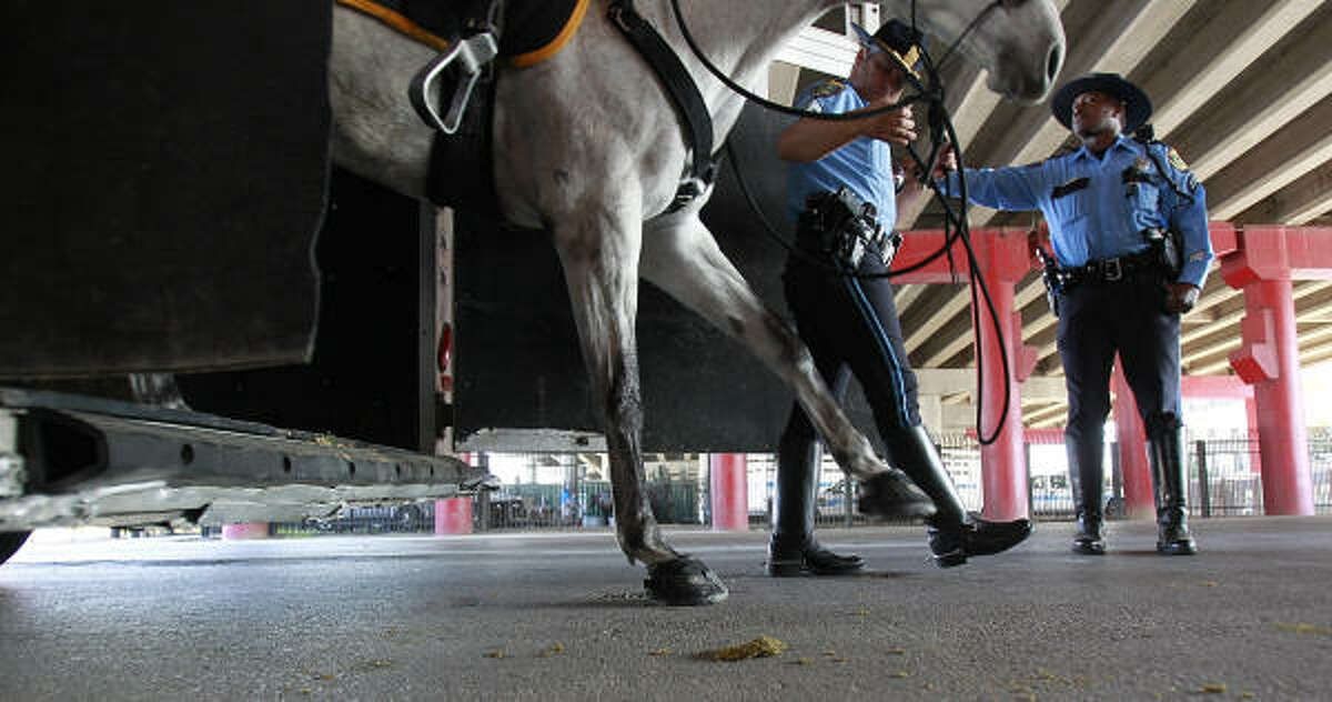 Newly appointed mounted patrol officer, Sgt. David Cadieux walks his horse named Hanner out of a trailer on the east side of downtown.
