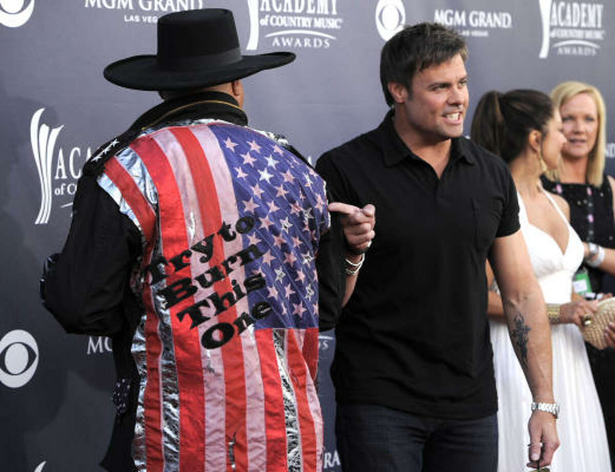 Eddie Montgomery, left, and Troy Gentry of Montgomery Gentry arrive at the 46th Annual Academy of Country Music Awards.