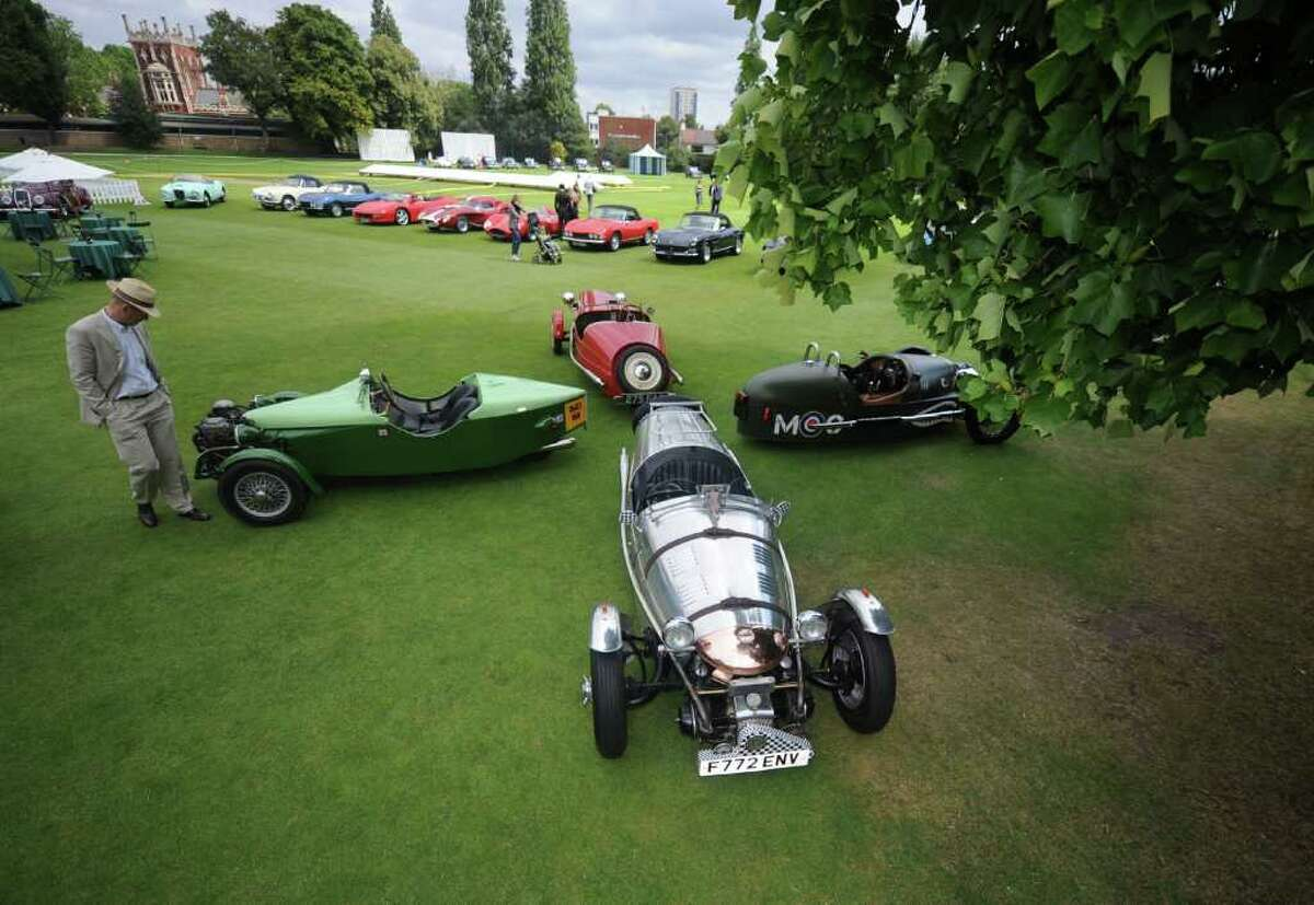 Vintage three-wheel cars on display at Concours D'Elegance at The Hurlingham Club on July 27, 2011 in London, England.