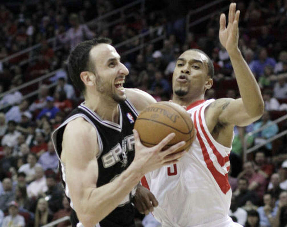 April 1: Rockets 119, Spurs 114 (OT) RocketsSan Antonio's Manu Ginobili, left, runs into Rockets guard Courtney Lee during the first half Friday night's game at Toyota Center.