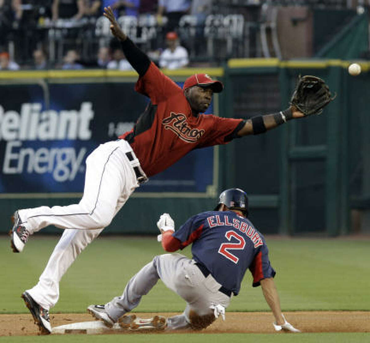 Astros second baseman Bill Hall, left, cannot get to the ball in time for an out on Jacoby Ellsbury (2) for a steal.