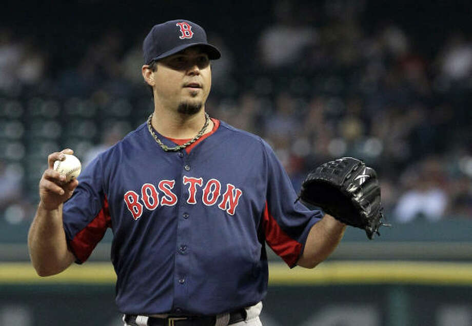 Red Sox pitcher Josh Beckett waits for a batter to get ready during the first inning. Photo: Pat Sullivan, AP