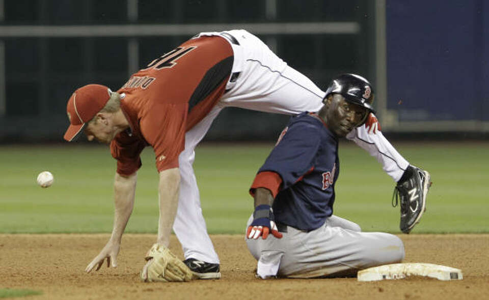 Astros shortstop Matt Downs, left, falls over Red Sox Mike Cameron, who was out at second base, in t