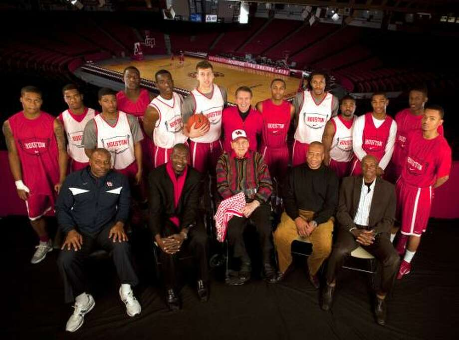 "Phi Slama JamaSome members of the Phi Slama Jama fraternity include (sitting, from left) Michael ""Silent Assassin"" Young, Hakeem ""The Dream"" Olajuwon, head coach Guy Lewis, Larry ""Mr. Mean"" Micheaux and Clyde ""The Glide"" Drexler. ""Phi Slama Jama"" was the nickname given to the University of Houston's men's basketball teams from 1982-84. The teams were well known for their slam dunks and fast-break style of play. The program advanced to the NCAA Final Four each year from 1982 to 1984, losing in the national championship game in both 1983 and 1984. Photo: Johnny Hanson And Nick De La Torre, Chronicle"