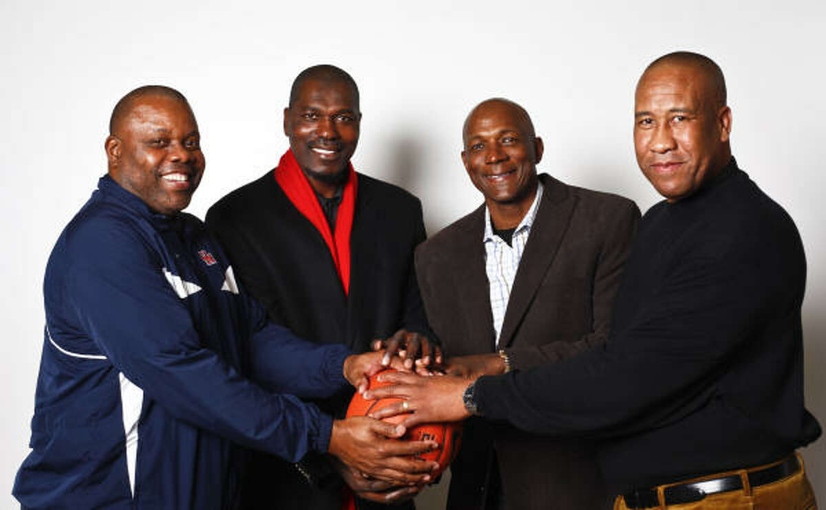 Phi Slama Jama (From left) Michael Young, Hakeem Olajuwon, Clyde Drexler and Larry Micheaux helped the UH men's basketball team reach the Final Four in three straight years from 1982-84. Olajuwon and Drexler both went on to have illustrated NBA careers and were inducted into the Basketball Hall of Fame.