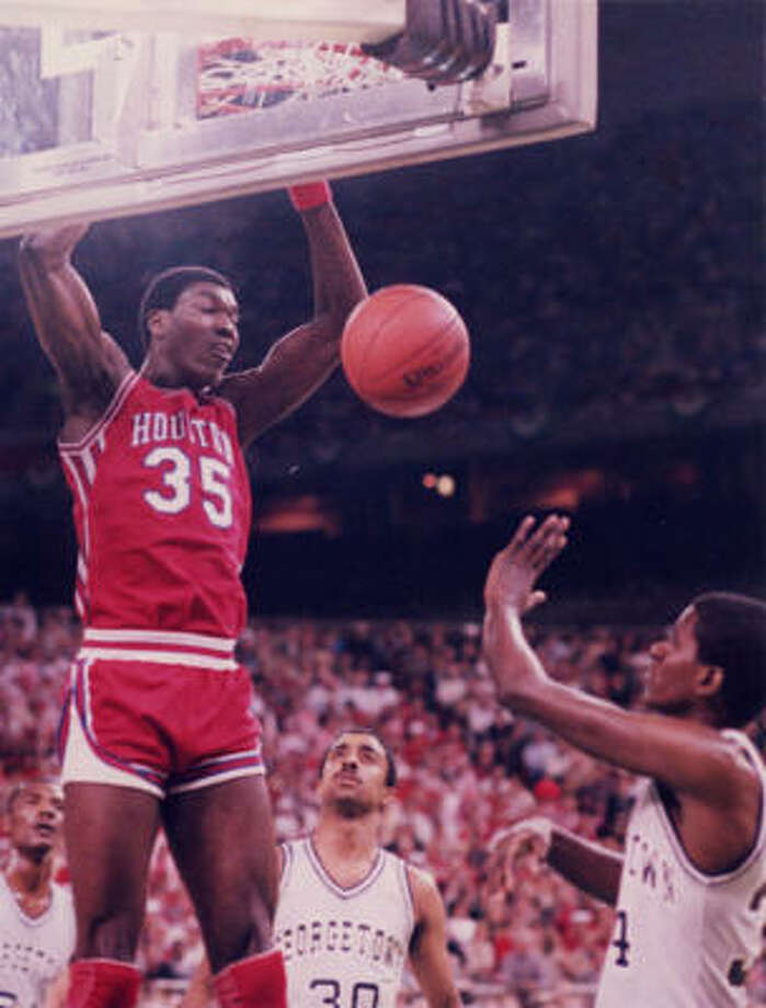 Hakeem Olajuwon Olajuwon (35) was a key player on the Phi Slama Jama teams of 1982-84. As a junior in 1984, he averaged 16.8 points, 13.5 rebounds and 5.6 blocks per game en route to leading the Cougars to their second consecutive national championship game, where they lost to Georgetown. Olajuwon left school after that season and was drafted by the Houston Rockets with the No. 1 overall pick in the 1984 draft. He enjoyed a Hall of Fame career and won back-to-back NBA championships with the Rockets from 1994-95. Photo: Chronicle File Photo