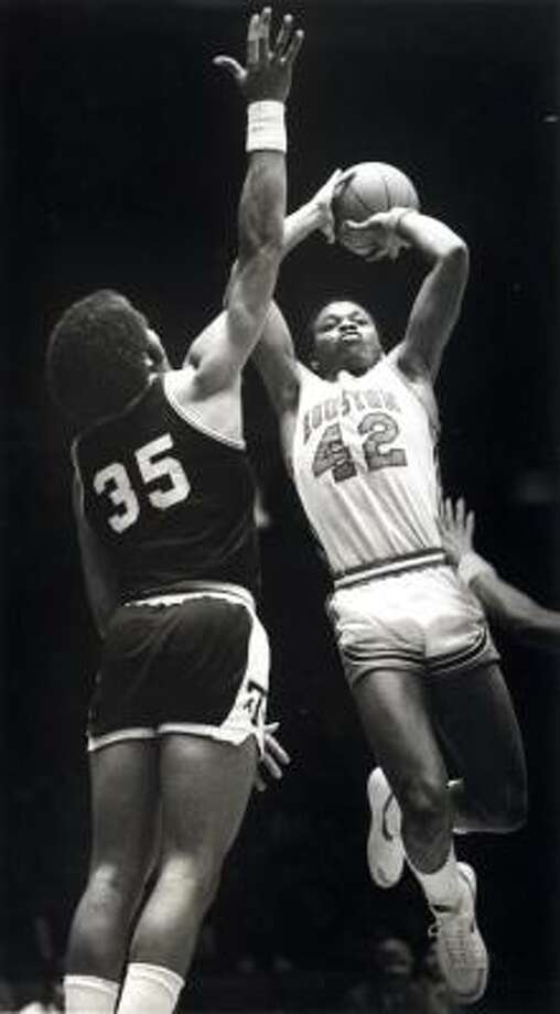 Michael Young Young (42), who starred at Yates High School, played at UH from 1980-84, averaging 15.3 points per game. He was an All-America second-team selection in 1984. Young now works at UH as the director of men's basketball operations. Photo: Chronicle File Photo