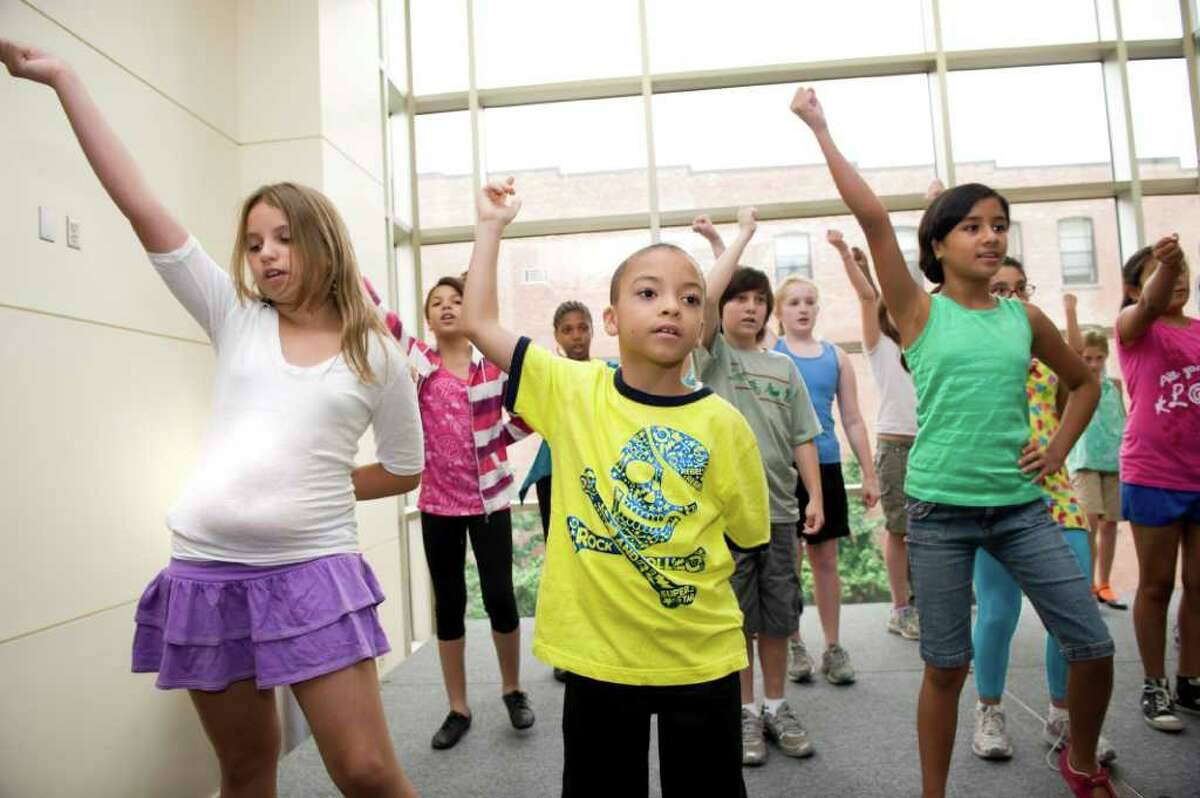 Sophia Schmitke (10), Nicholas Barlow (9) and Pamela Jaramillo (10 ) practice their dance moves at The Triple Threat Performer Intensive program at the Palace Theatre in Stamford, Conn. on Monday July 25, 2011.
