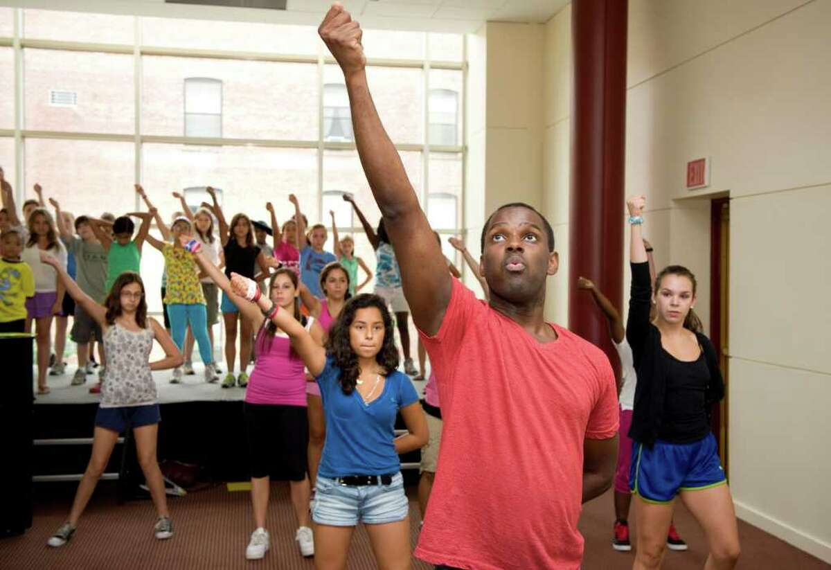 Arbender Robinson, director of The Triple Threat Performer Intensive Program, leads middle school students in a dance routine at the Palace Theatre in Stamford, Conn. on Monday July 25, 2011. The program offers classes in acting, dance and voice.