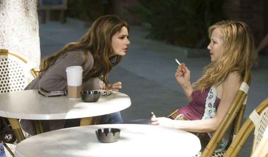 Laura San Giacomo, left, and Holly Hunter star in TNT's Saving Grace. Photo: ERIK HEINILA, TNT