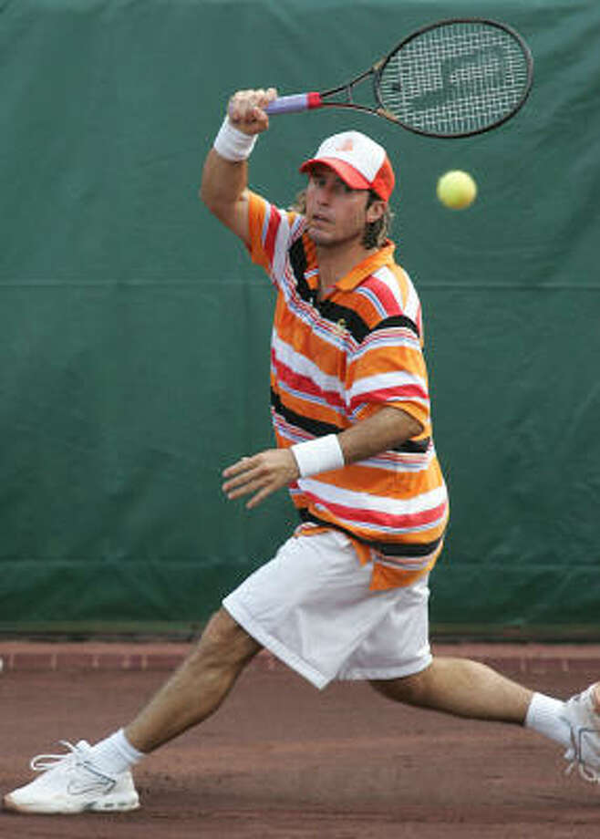 Vince Spadea of the United States hits the ball during a singles match against Victor Hanescu of Romania River Oaks International Tennis Tournament at River Oaks Country Club April 7, 2006 in Houston, Texas. Photo: James Nielsen, For The Chronicle