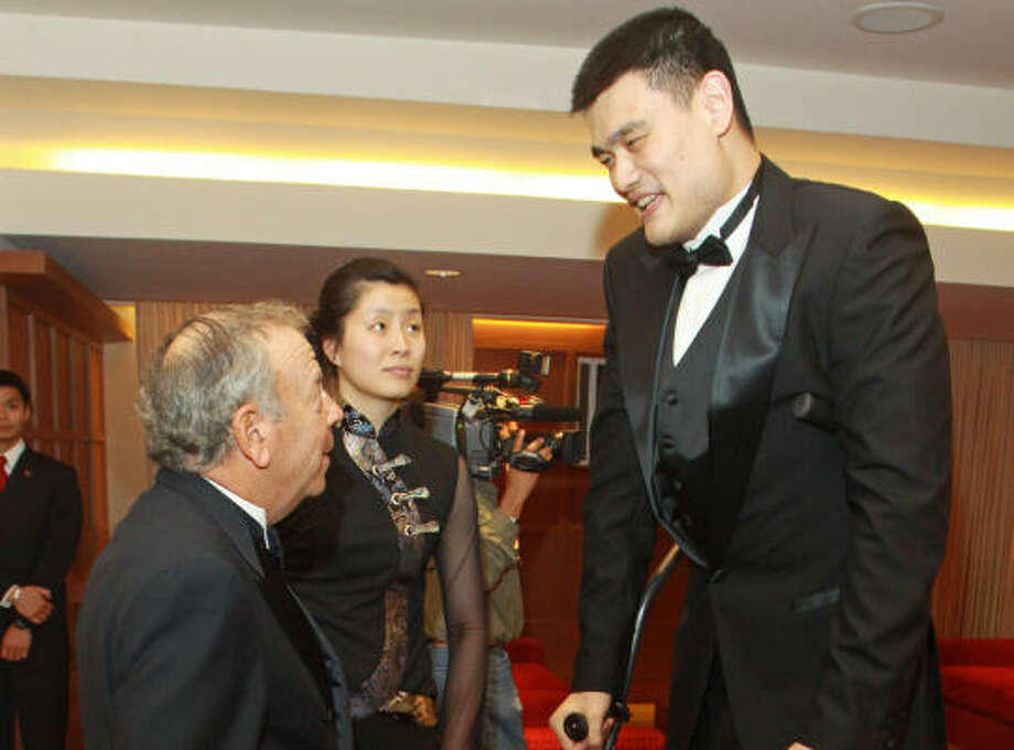 Rockets owner Leslie Alexander with Yao Ming and his wife Ye Li Photo: Gary Fountain