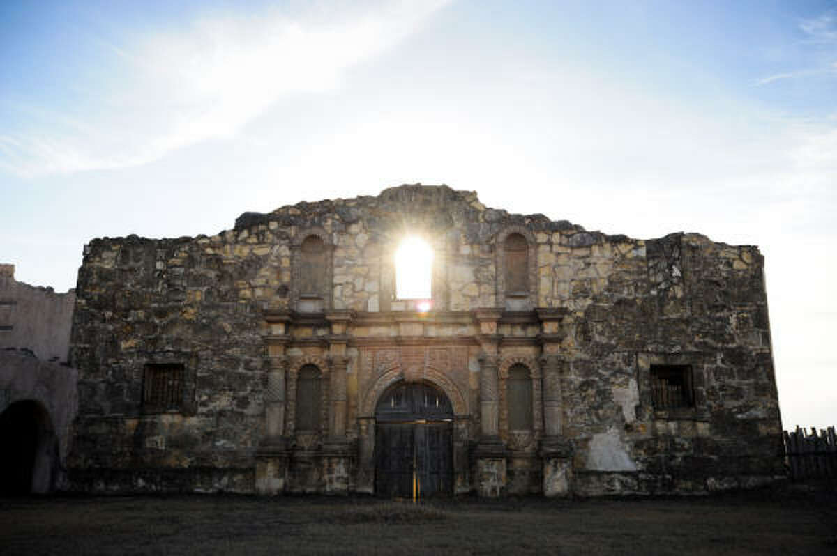 The sun sets behind a replica of the Alamo at Alamo Village just outside of town on Ranch Road 674.