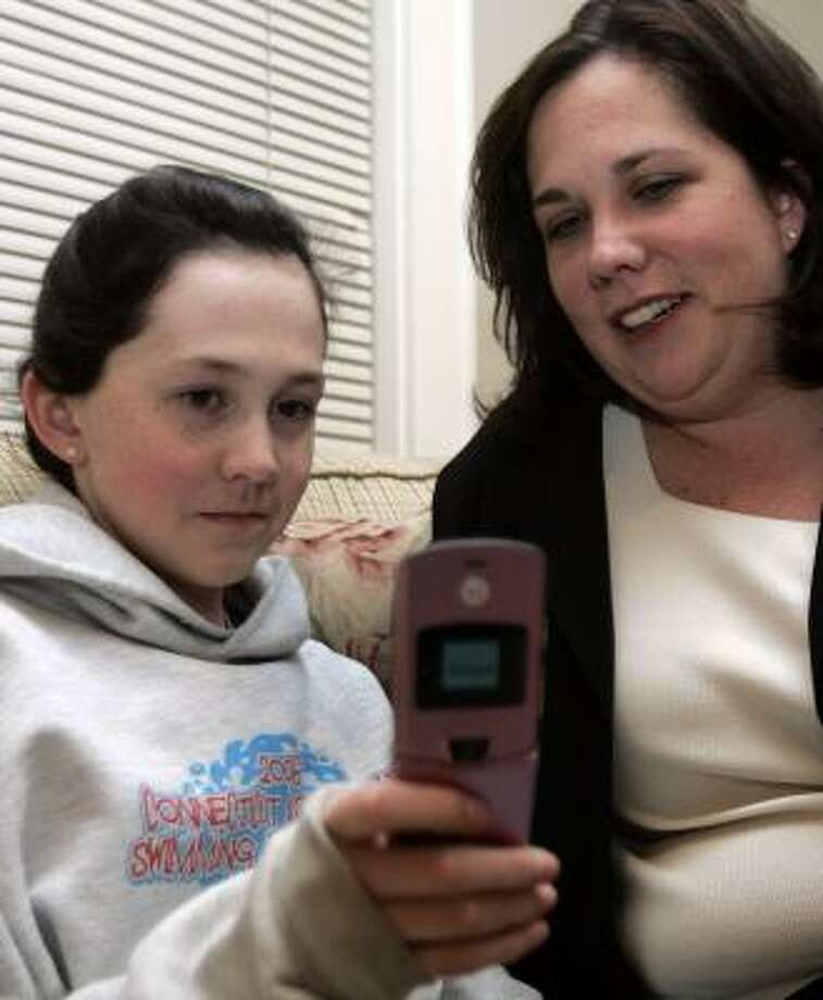 Kate Mulvany says that although her daughter Meghan, 12, wanted a cell phone for social reasons, she ultimately received one for safety reasons. Photo: BOB CHILD, AP FILE
