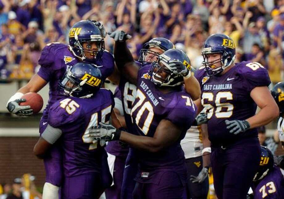 East Carolina, above, and BYU have pushed themselves into the BCS picture. Photo: Sara D. Davis, AP