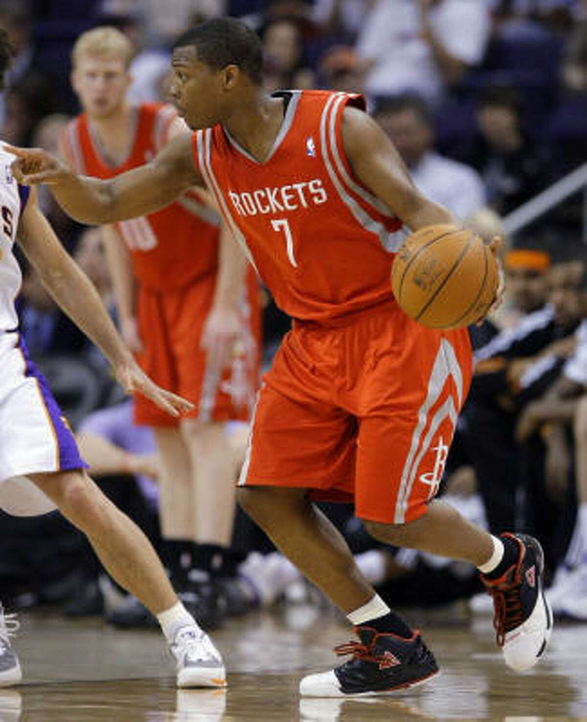 Rockets guard Kyle Lowry pushes the ball upcourt.