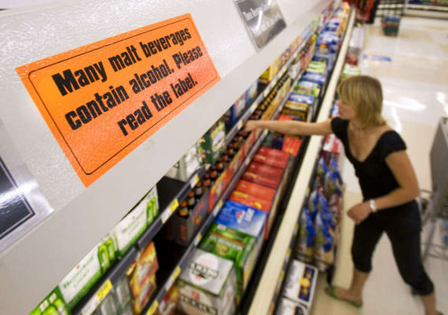 Only a warning sign about malt beverages is left in a grocery store Tuesday in Salt Lake City. Photo: Douglas C. Pizac