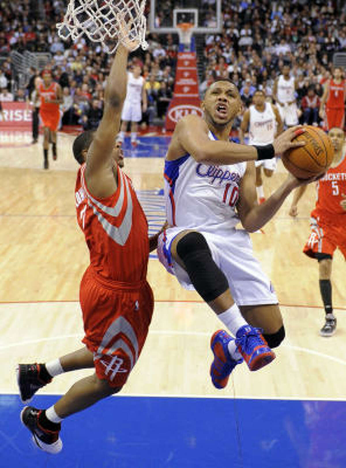 Clippers guard Eric Gordon, right, goes up for a shot over Rockets guard Kyle Lowry.