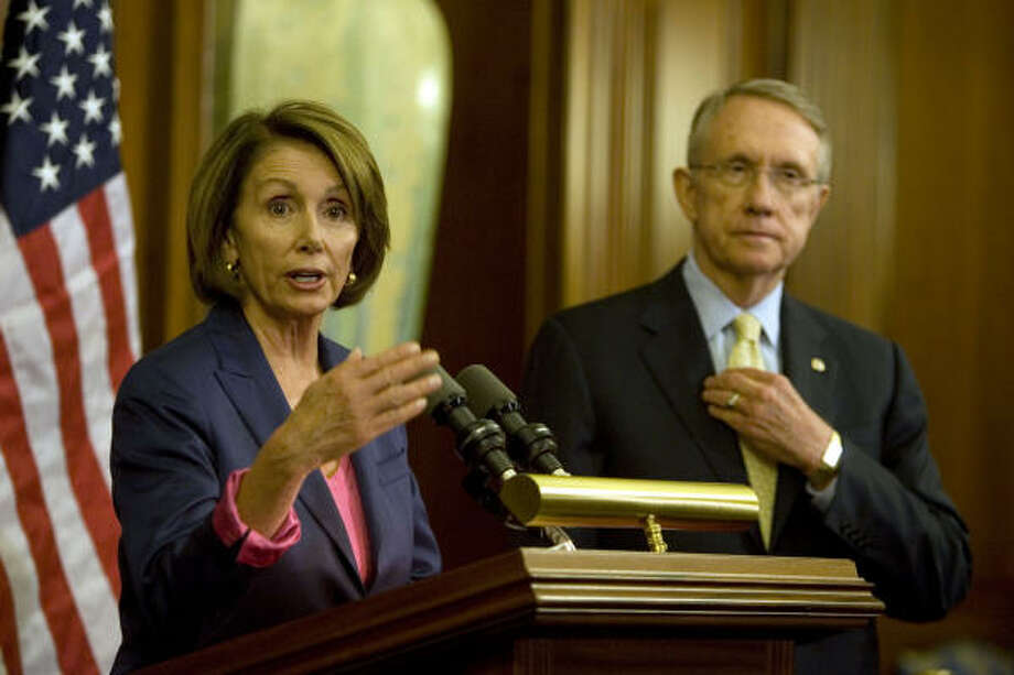 House Speaker Nancy Pelosi and Senate Majority Leader Harry Reid talk with reporters during a news conference on the financial crisis on Capitol Hill on Sunday. Photo: Evan Vucci, Associated Press