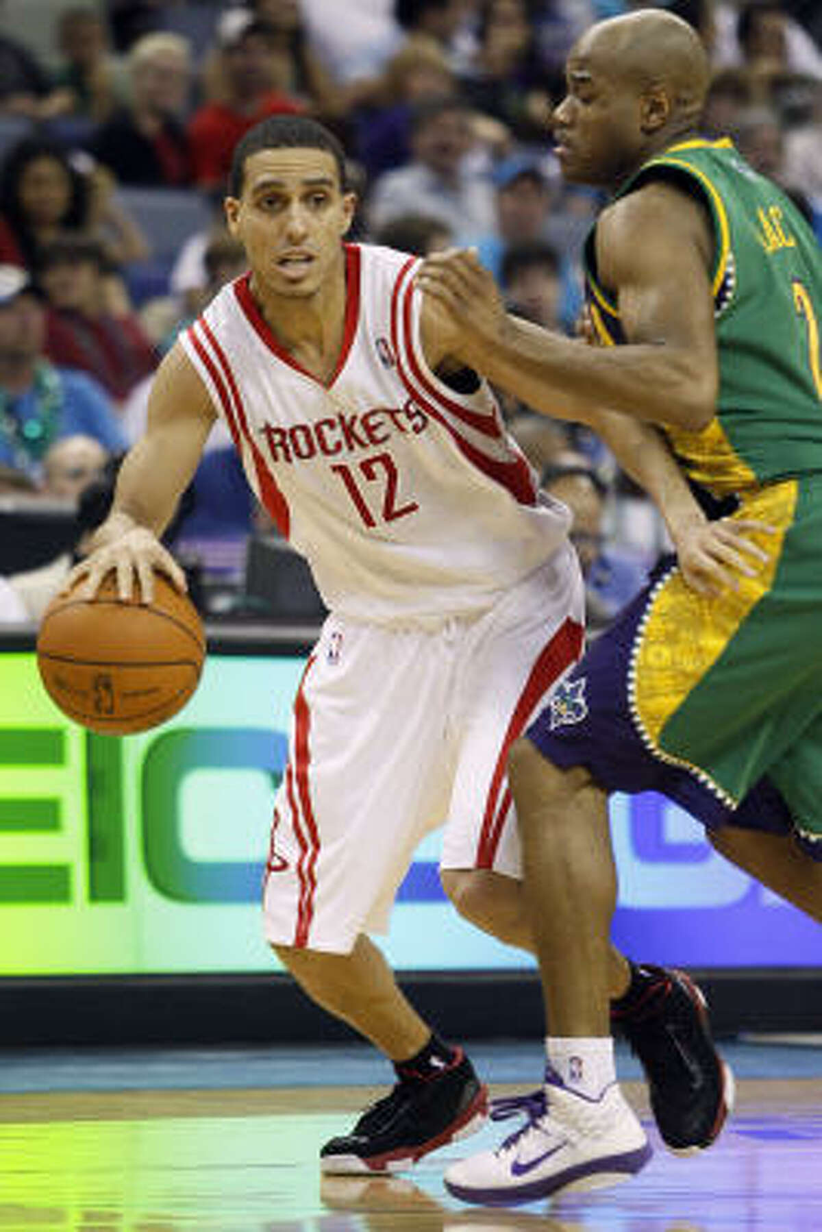Rockets guard Kevin Martin (12) drives to the basket around Hornets point guard Jarrett Jack. Martin contributed a game-high 33 points to Houston's victory.