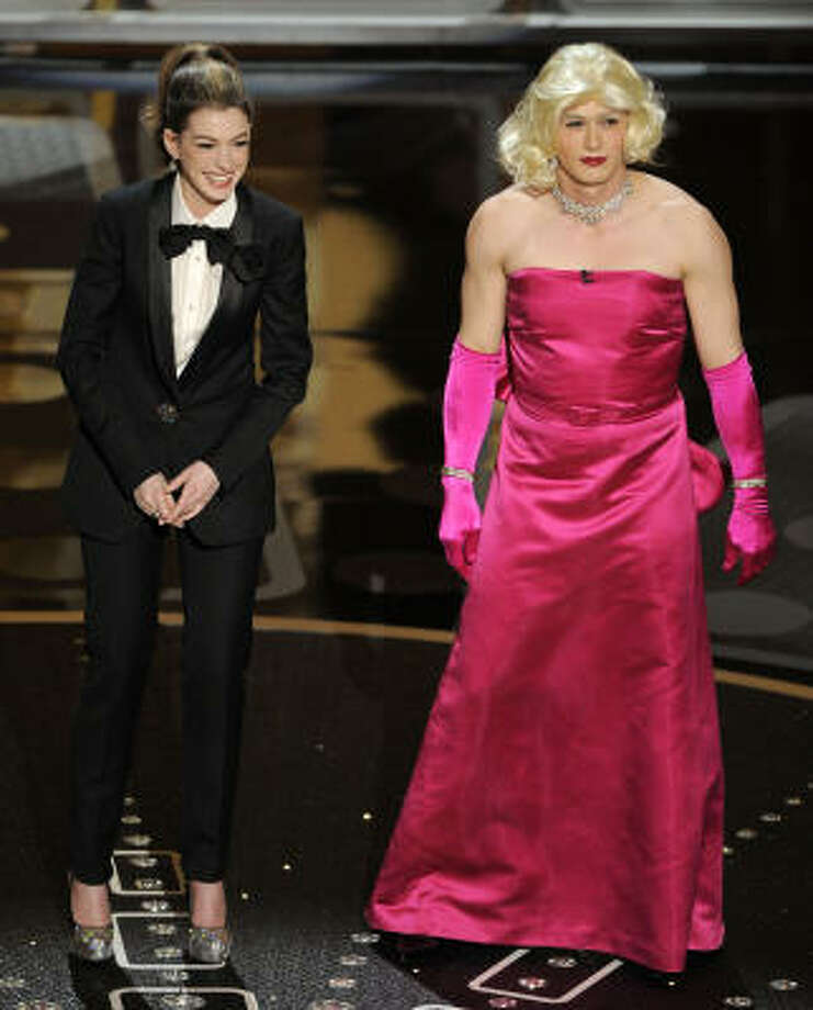 Silly:2011 show hosts Anne Hathaway, left, and James Franco play it up in drag. Photo: Mark J. Terrill, AP