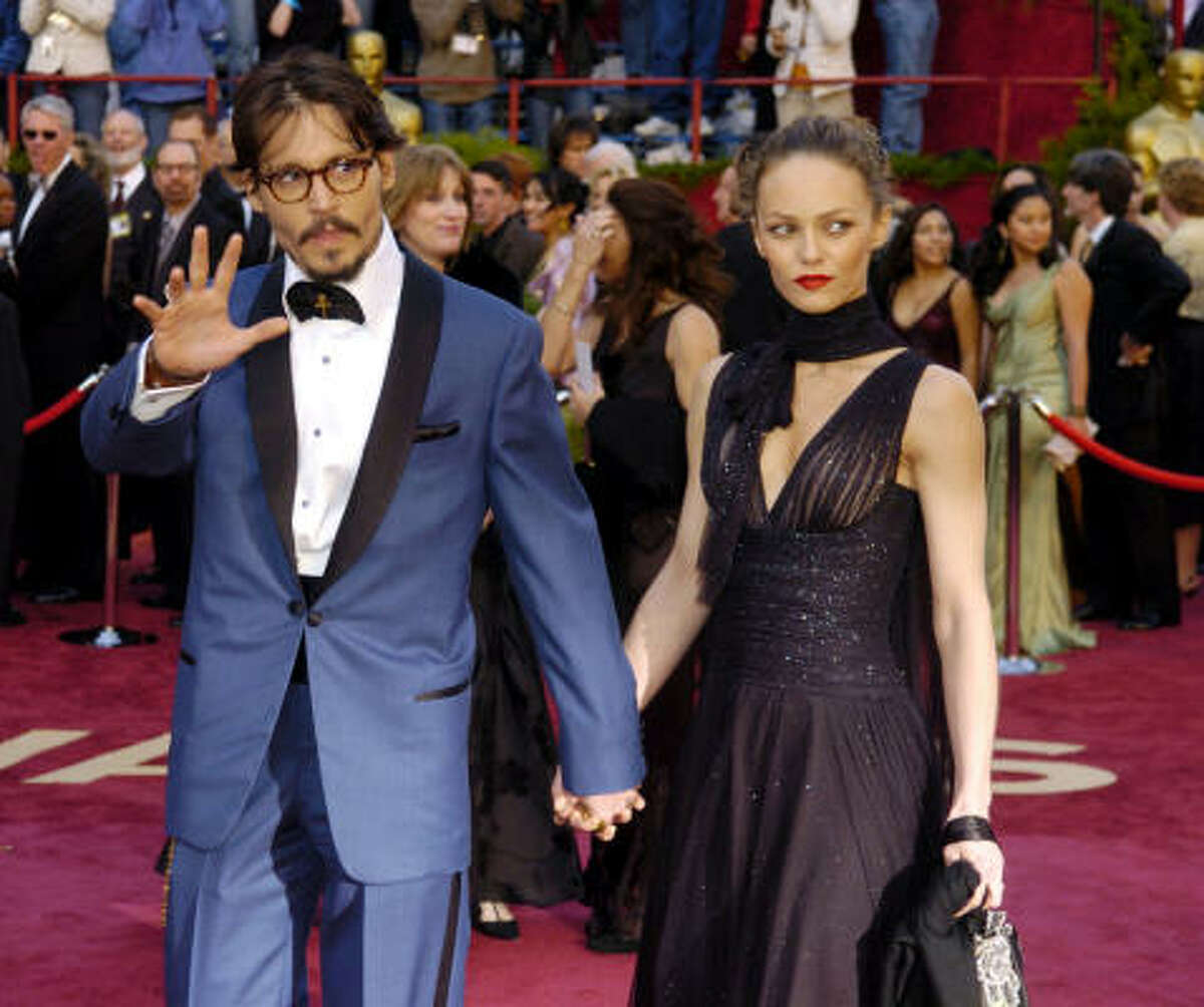 Flashy: Johnny Depp declined to stick with the traditional at the 2005 Oscars and chose a powder-blue tuxedo.