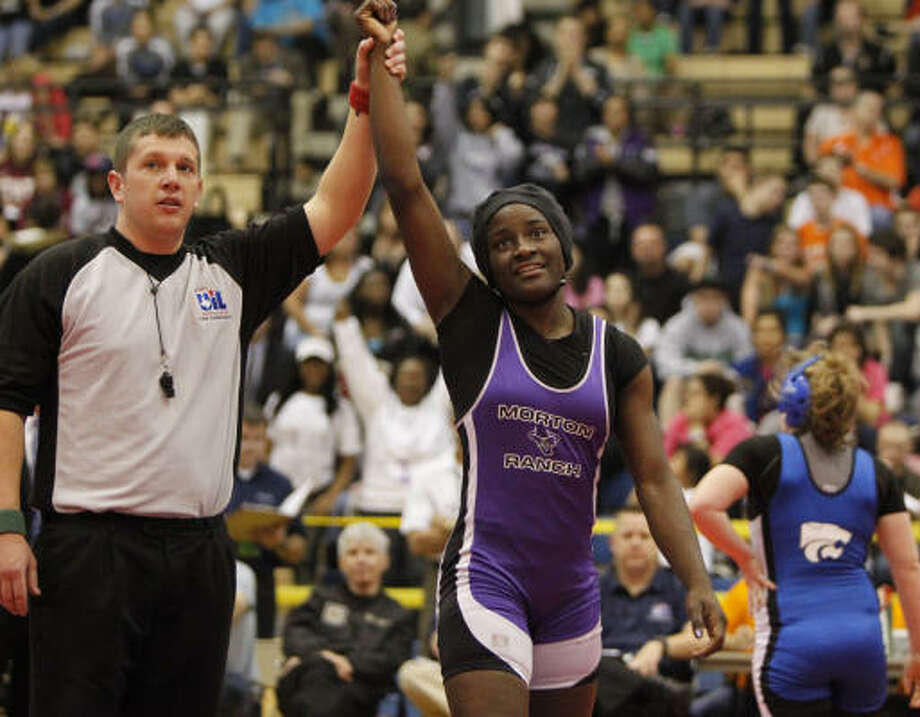 Morton Ranch's Tamyra Mensah became a two-time state wrestling champ after defeating Cypress Creek's Anna McAleavy in the 138-pound class of Saturday's UIL state wrestling tournament in Austin. Photo: Erich Schlegel, For The Chronicle