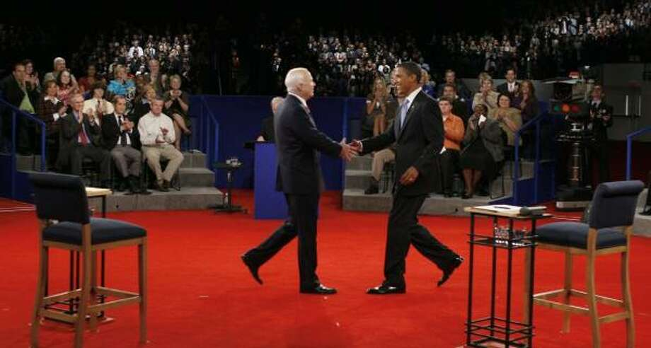 Sens. John McCain and Barack Obama shake hands before the town hall debate Tuesday at Belmont University in Nashville, Tenn. Photo: JIM BOURG, GETTY IMAGES